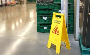Cleaning in progress sign in a supermarket