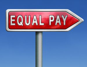 Sign post pointing towards equal pay